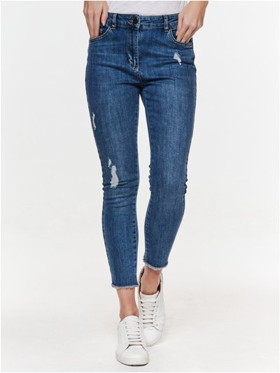 Petite ripped skinny jeans