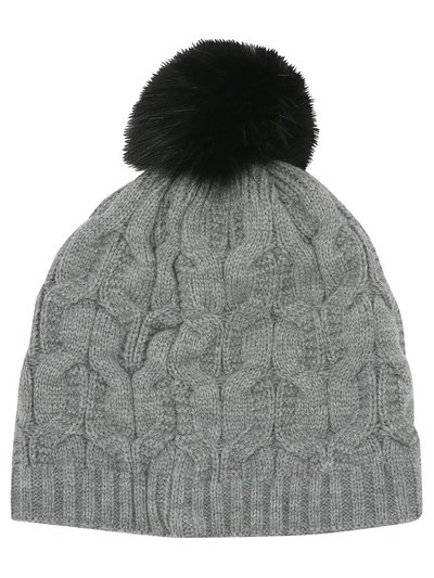 Faux fur lined knitted hat with pom pom